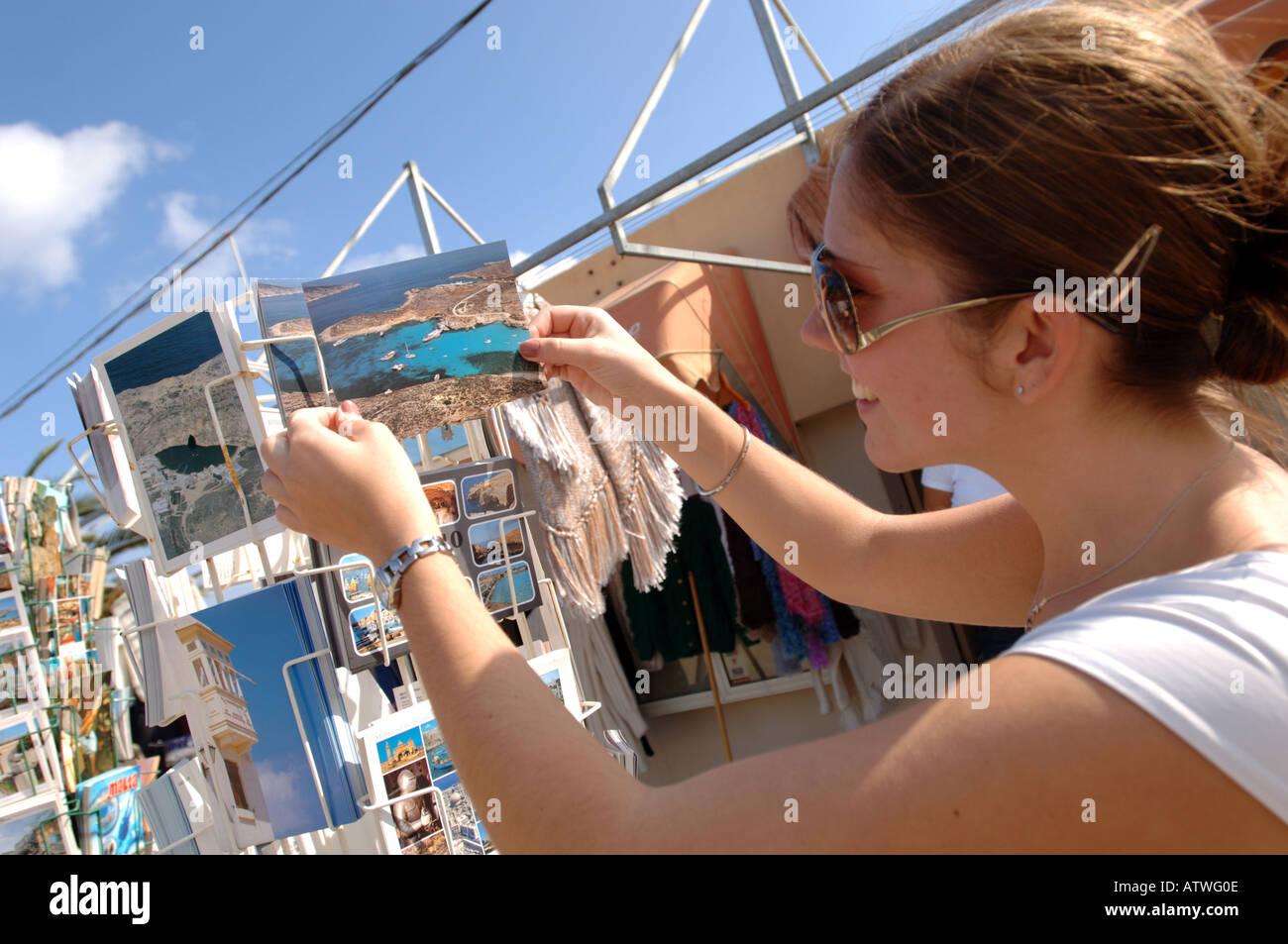 Tourist buying postcard Gozo The Island of Malta - Stock Image