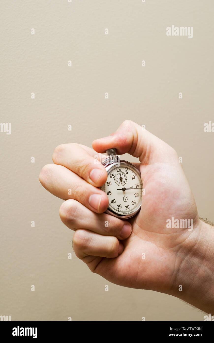Hand holding stopwatch chronometer - Stock Image