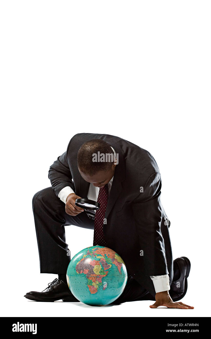 People white background young black african american in business suit magnifying glass studio white background. - Stock Image