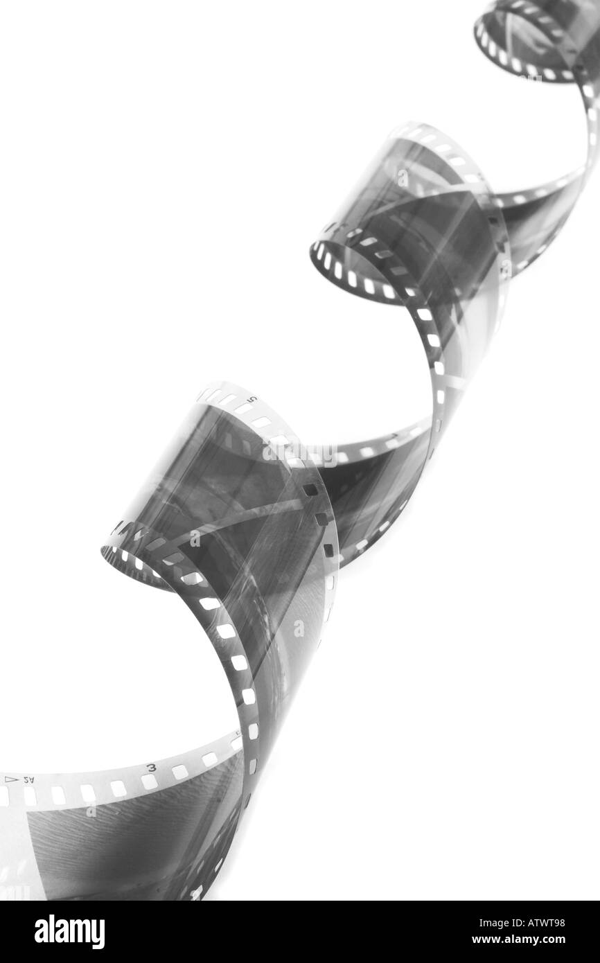 Curled black and white film - Stock Image