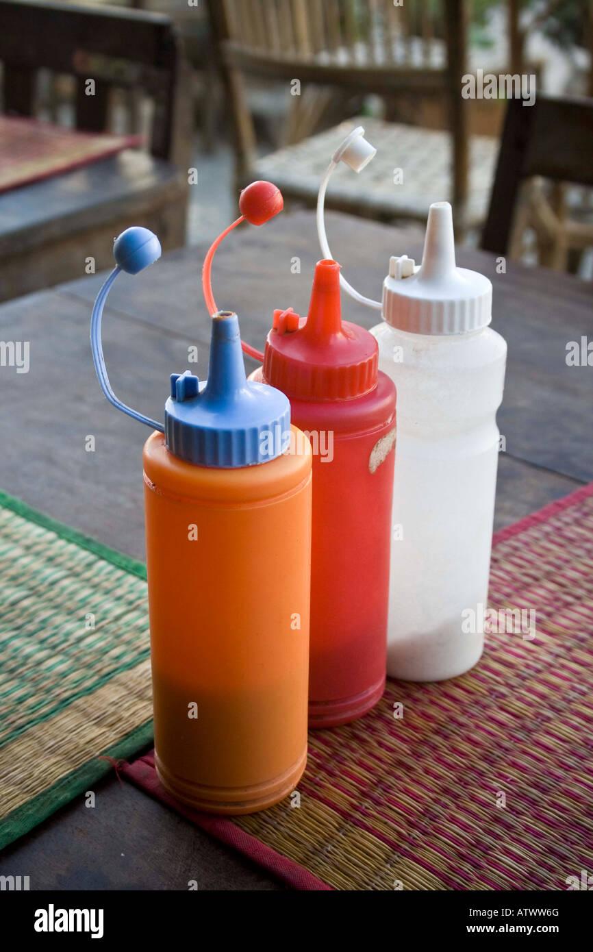 Sauce Containers Smokin Pot Restaurant Battambang Cambodia - Stock Image