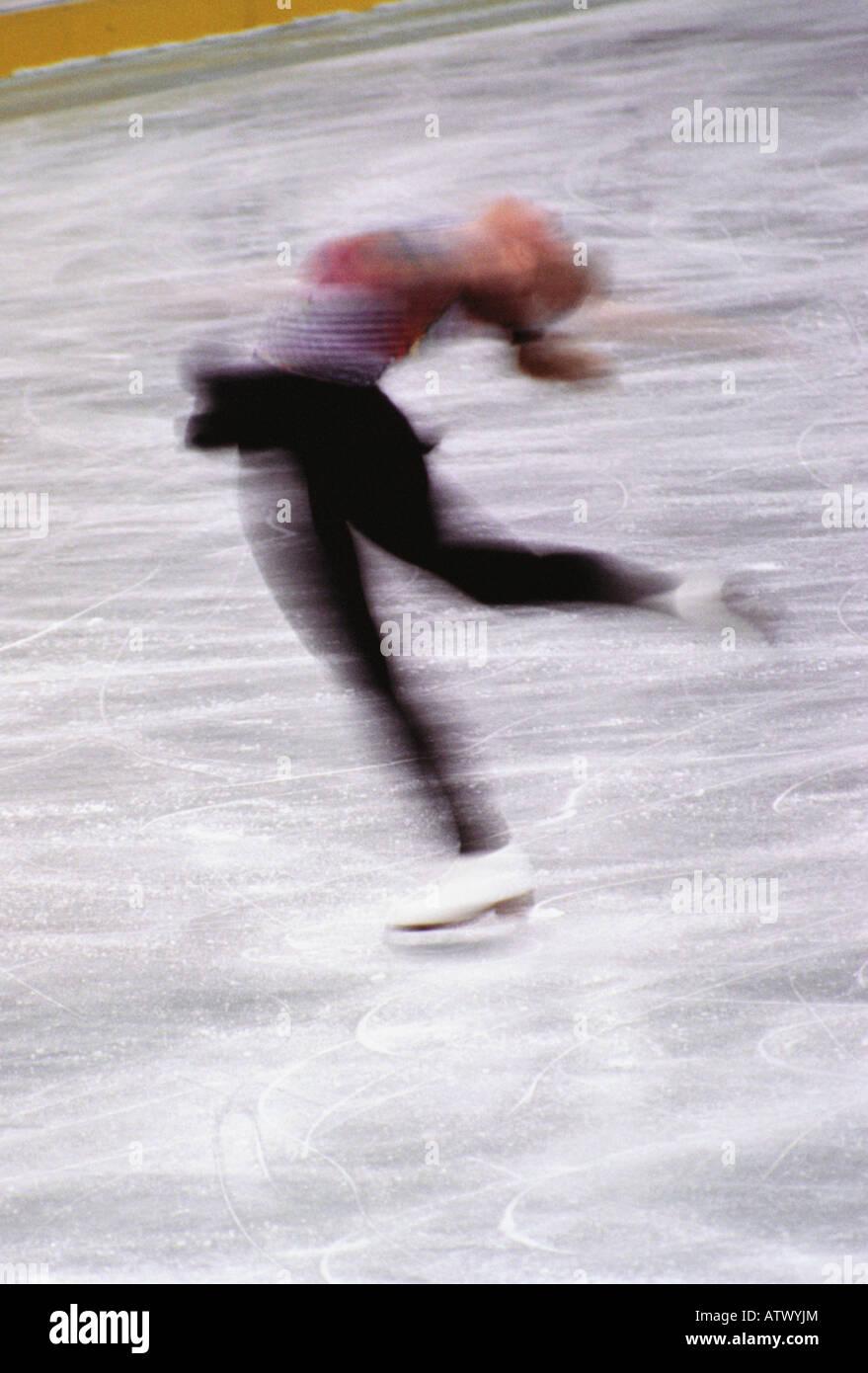 female ice skater in motion - Stock Image