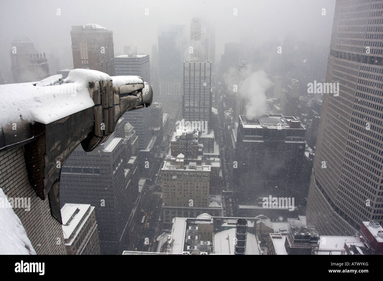 The first big snowfall of the year hits New York City as seen from the Chrysler Building. - Stock Image