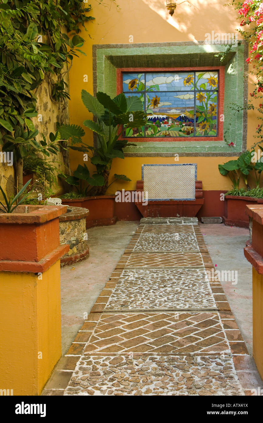 MEXICO Guanajuato Potted plants benches stained glass in Italian garden ex hacienda de San Gabriel de Barrera - Stock Image