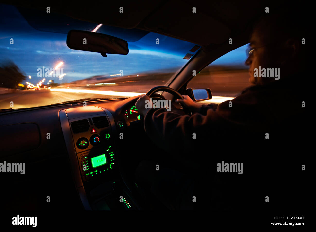 Night Drive Holden Commodore 2003 model at night in New Zealand Stock Photo