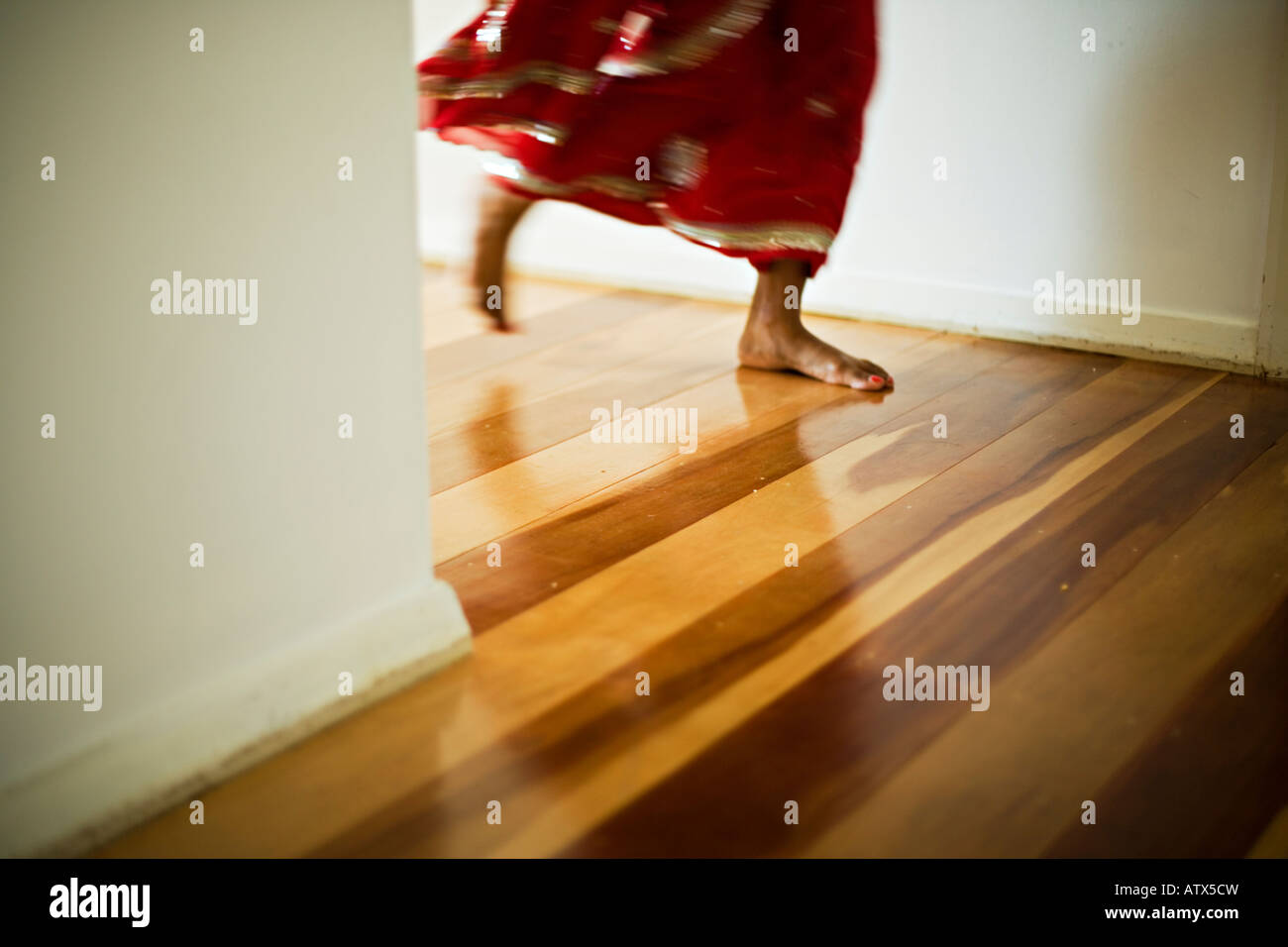 Feet of a woman in red sari - Stock Image