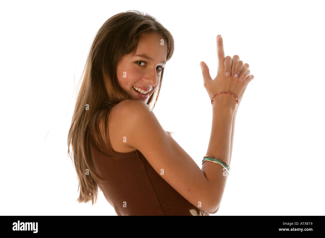 Young woman looking at camera gesture from 007 movie - Stock Image