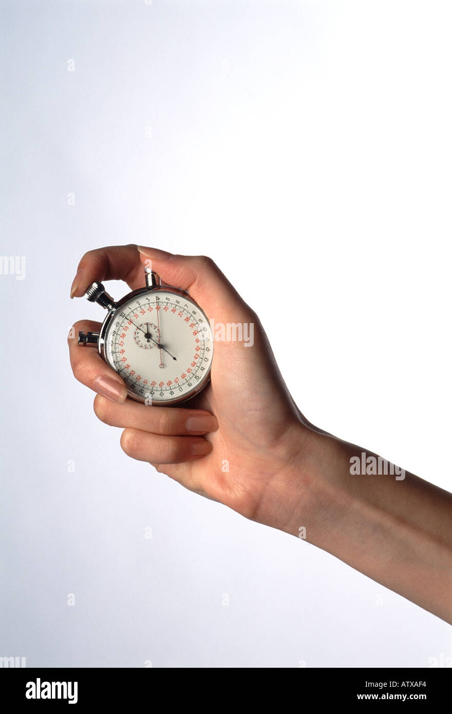 female hand holding a stopwatch - Stock Image