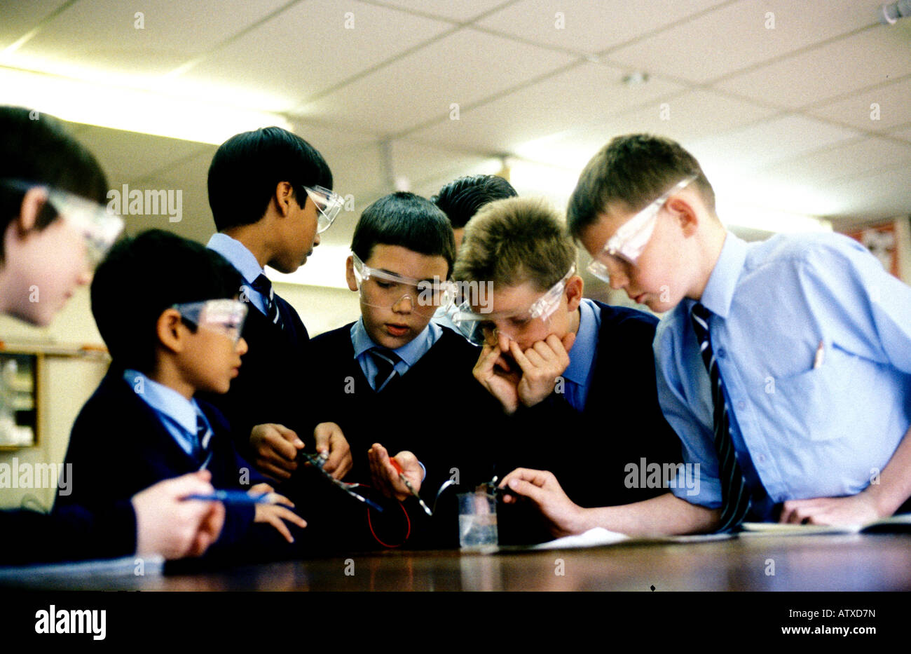 Secondary school children performing a science experiment at a CTC school in South London - Stock Image