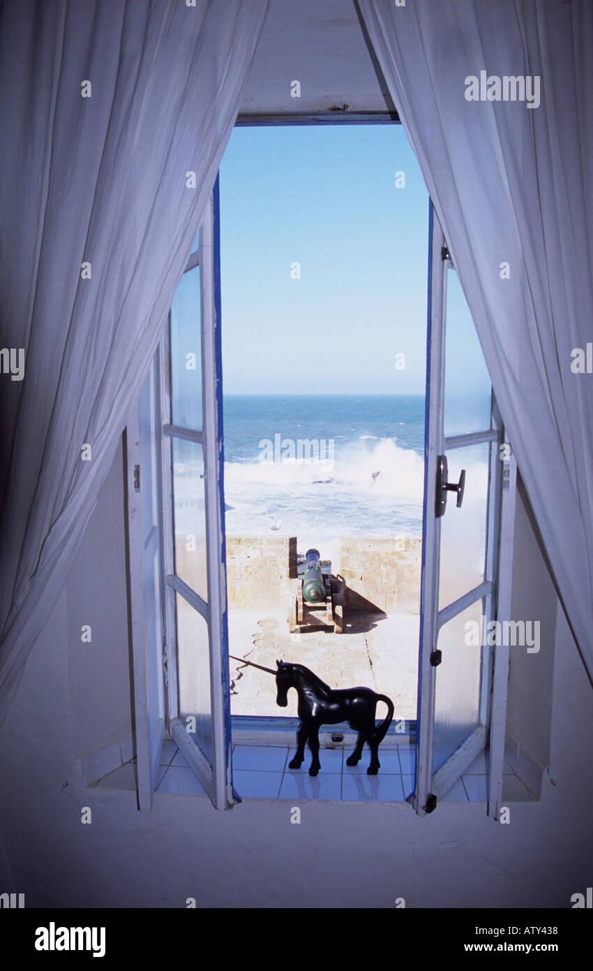 Morocco La Maison des Artistes window in hotel Essaouira - Stock Image