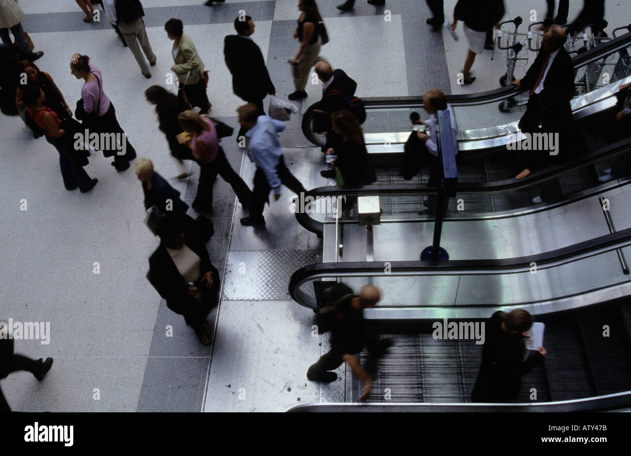 England commuters on Liverpool Street station escalator in London - Stock Image