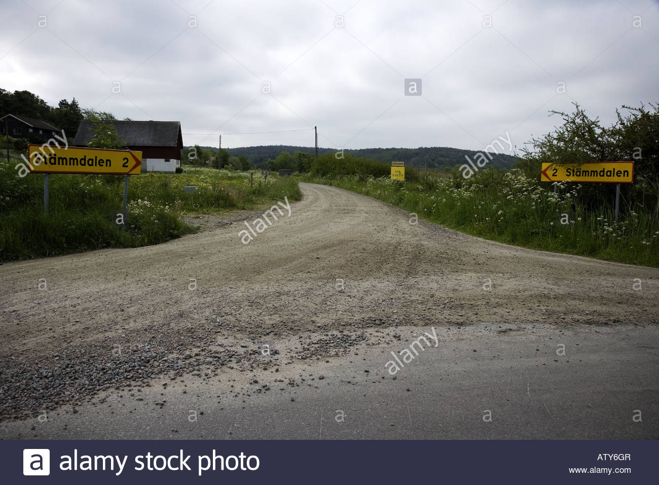 Road with signboards on each side - Stock Image