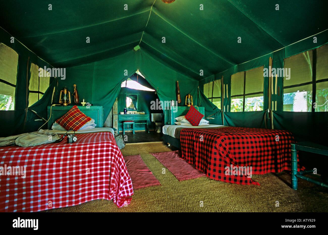AFRICA KENYA MASAI MARA Interior of luxurious tent at Kichwa Tembo safari camp in the Masai Mara Reserve - Stock Image