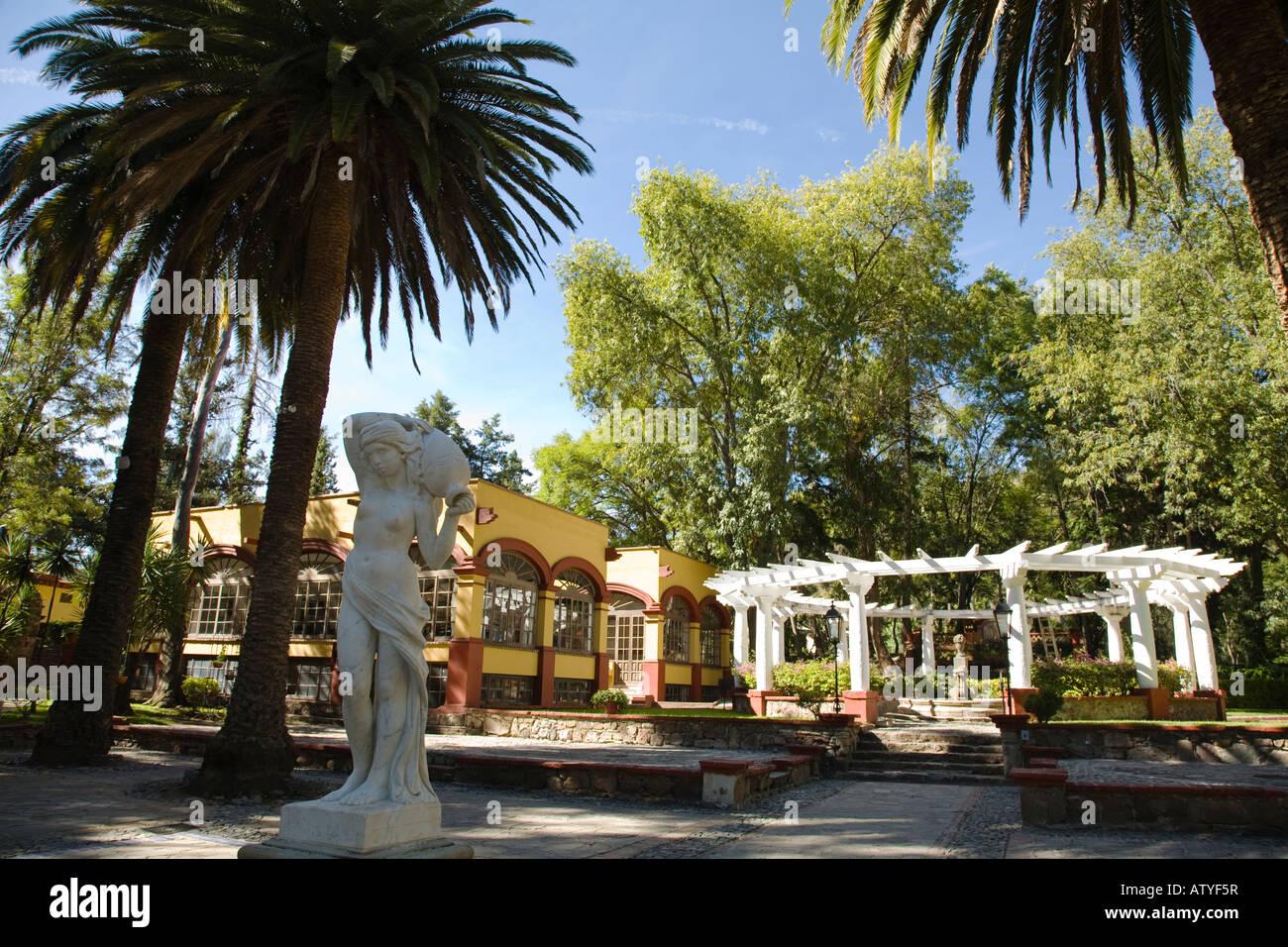 MEXICO Guanajuato Statue in plaza white pergola in garden ex hacienda de San Gabriel de Barrera Stock Photo