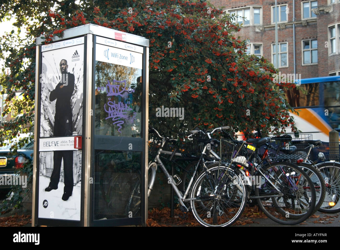 Public phone booth and bicycles in Bevington Road, Oxford - Stock Image