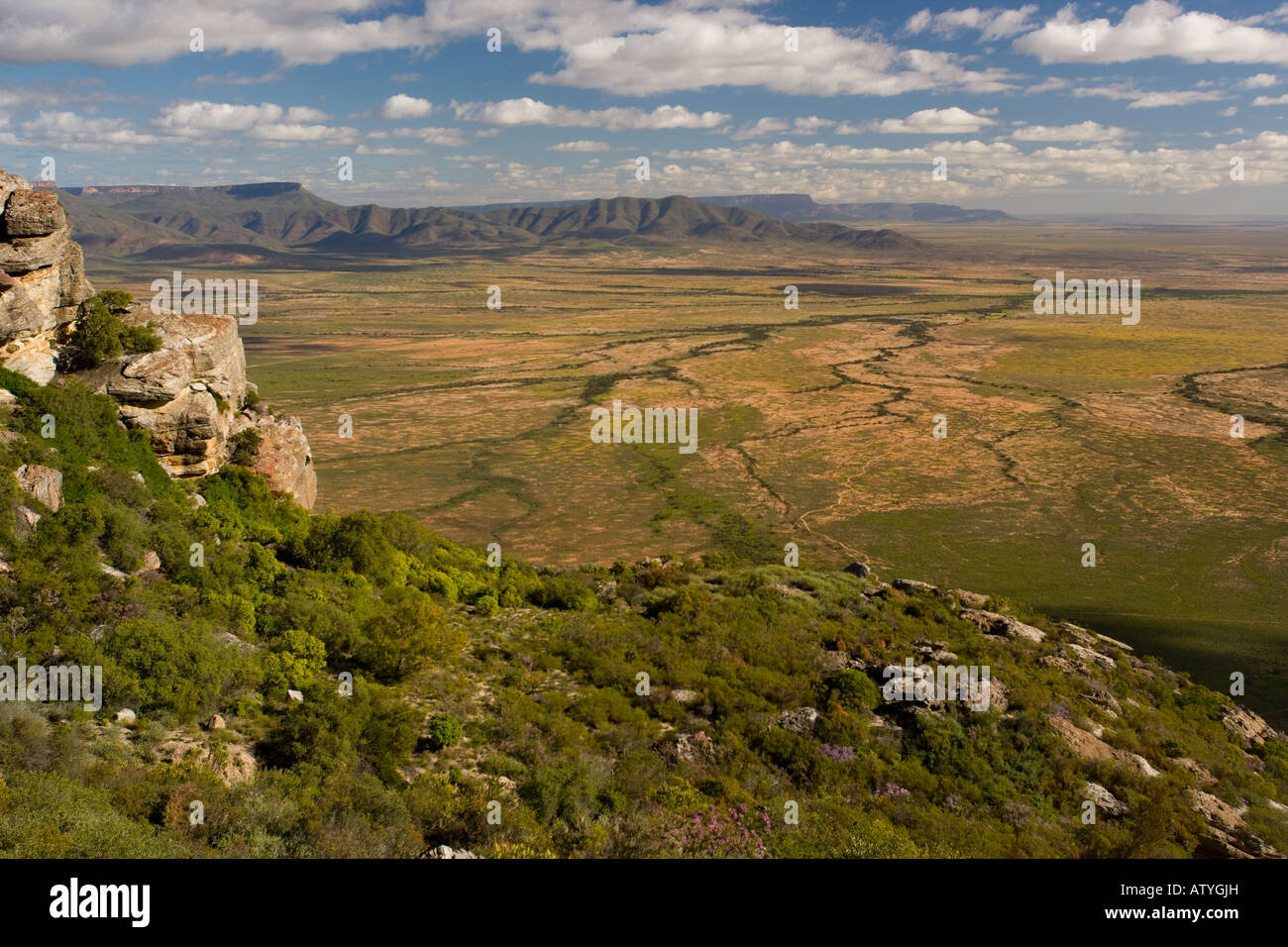 View west across the plains and the Sout Valley from the Bokkerveld Mountains western Cape South Africa - Stock Image
