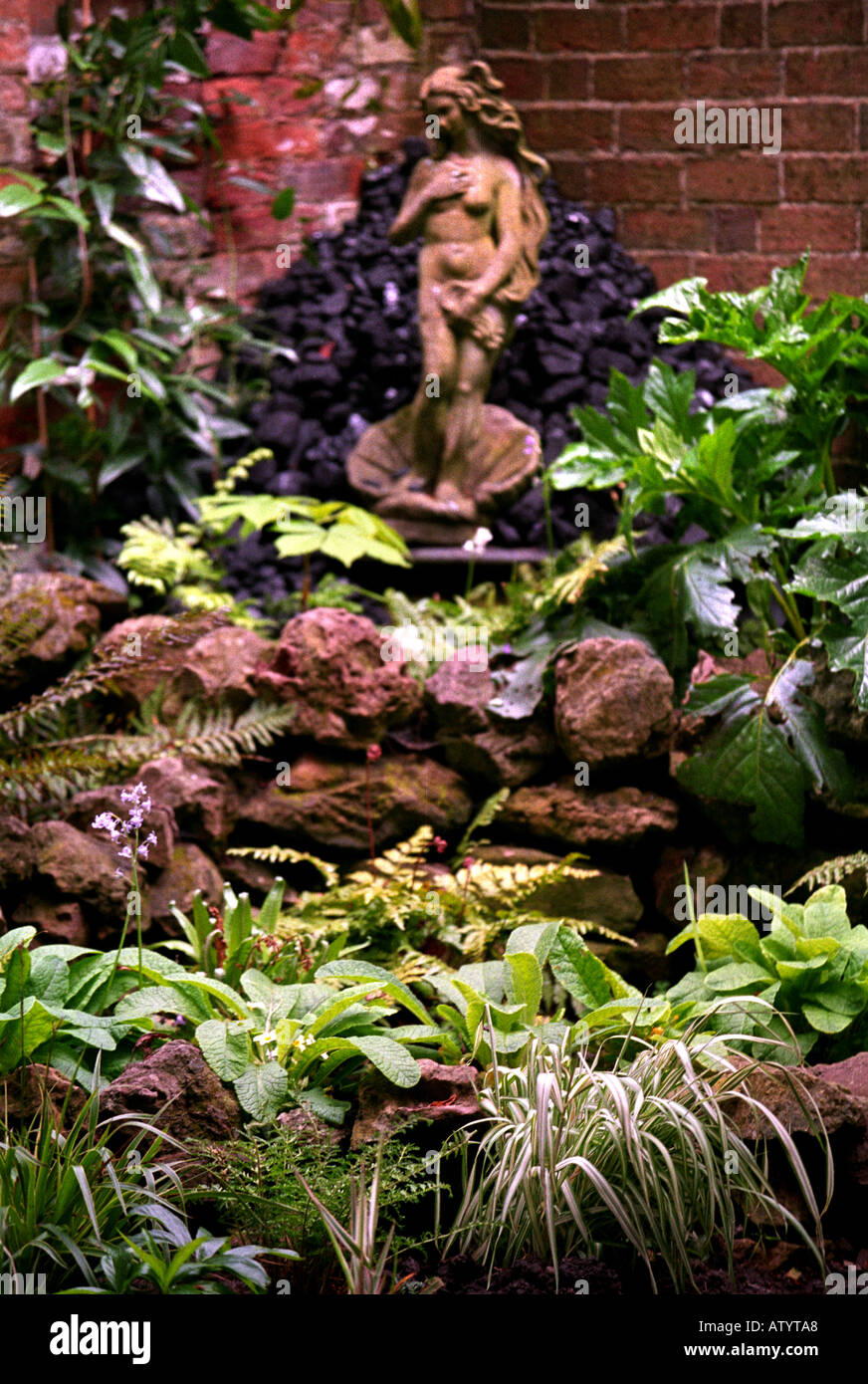 A ROCKERY WITH A STATUE OF VENUS IN THE STYLE OF BOTTICELLIS BIRTH OF VENUS Stock Photo