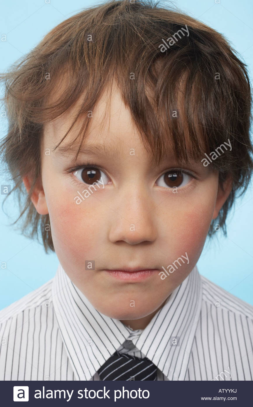 Young boy indoors looking at camera - Stock Image