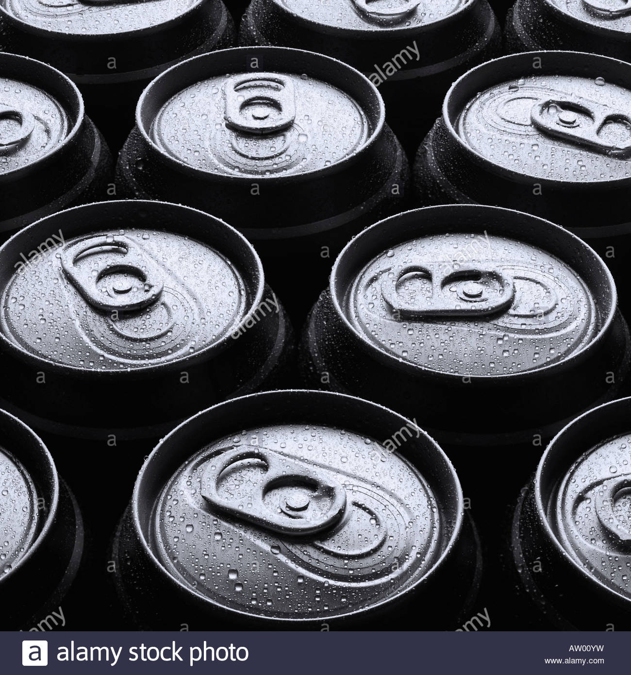 Eleven wet beer cans outdoors - Stock Image