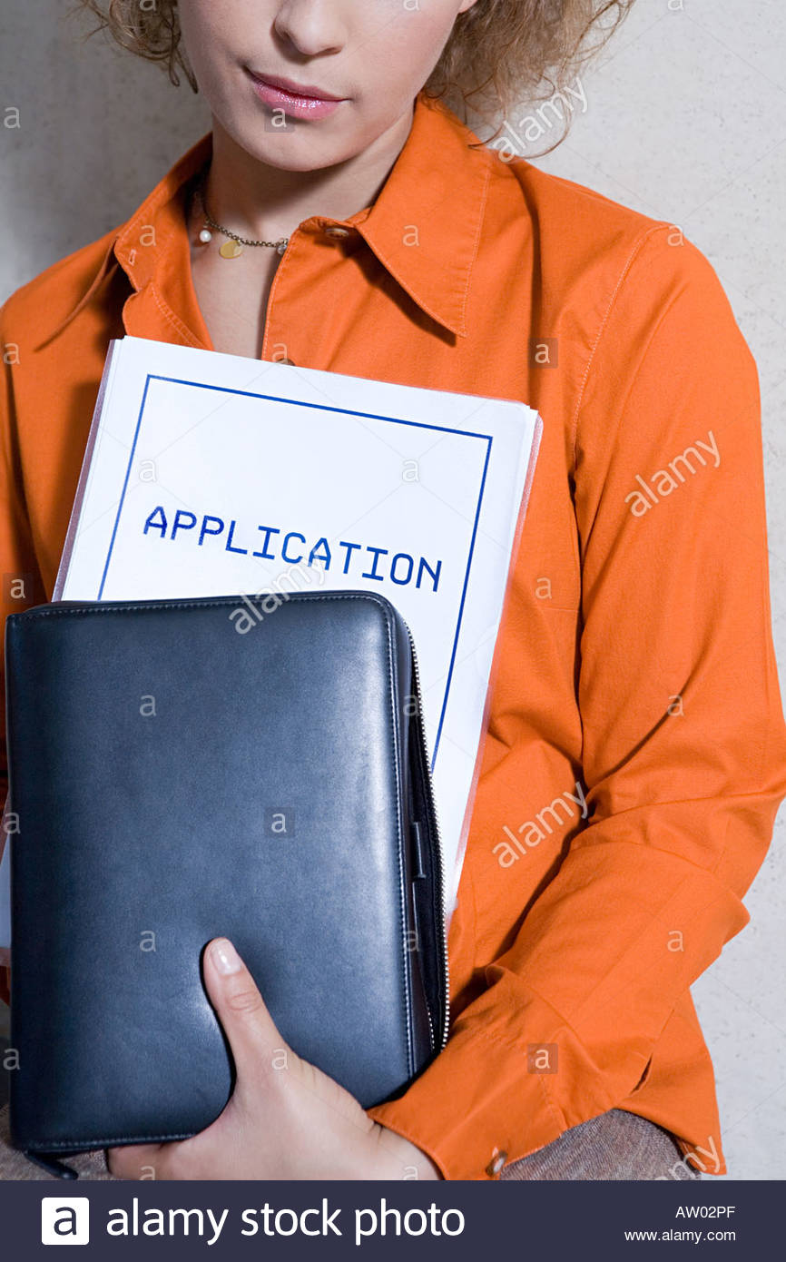Women with application form - Stock Image
