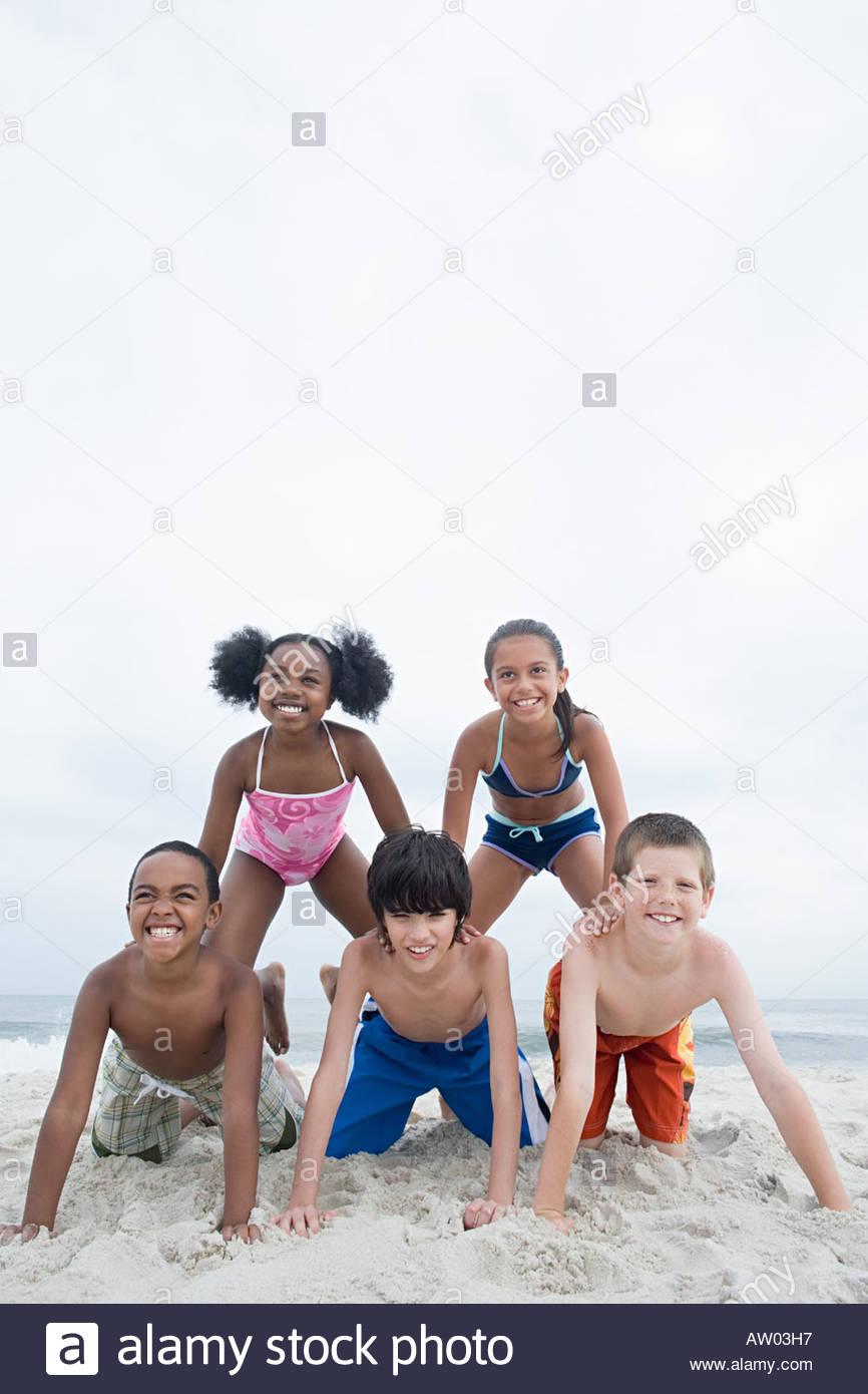 Children in balancing pose - Stock Image