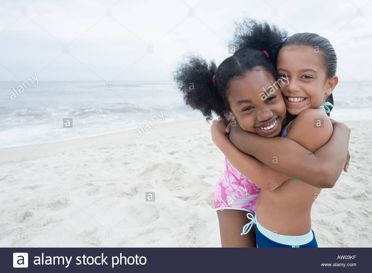 Two girls hugging - Stock Image