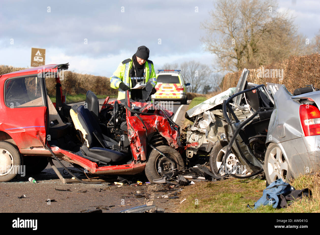 Police at the scene of a fatal head on car crash that killed 4 people - Stock Image