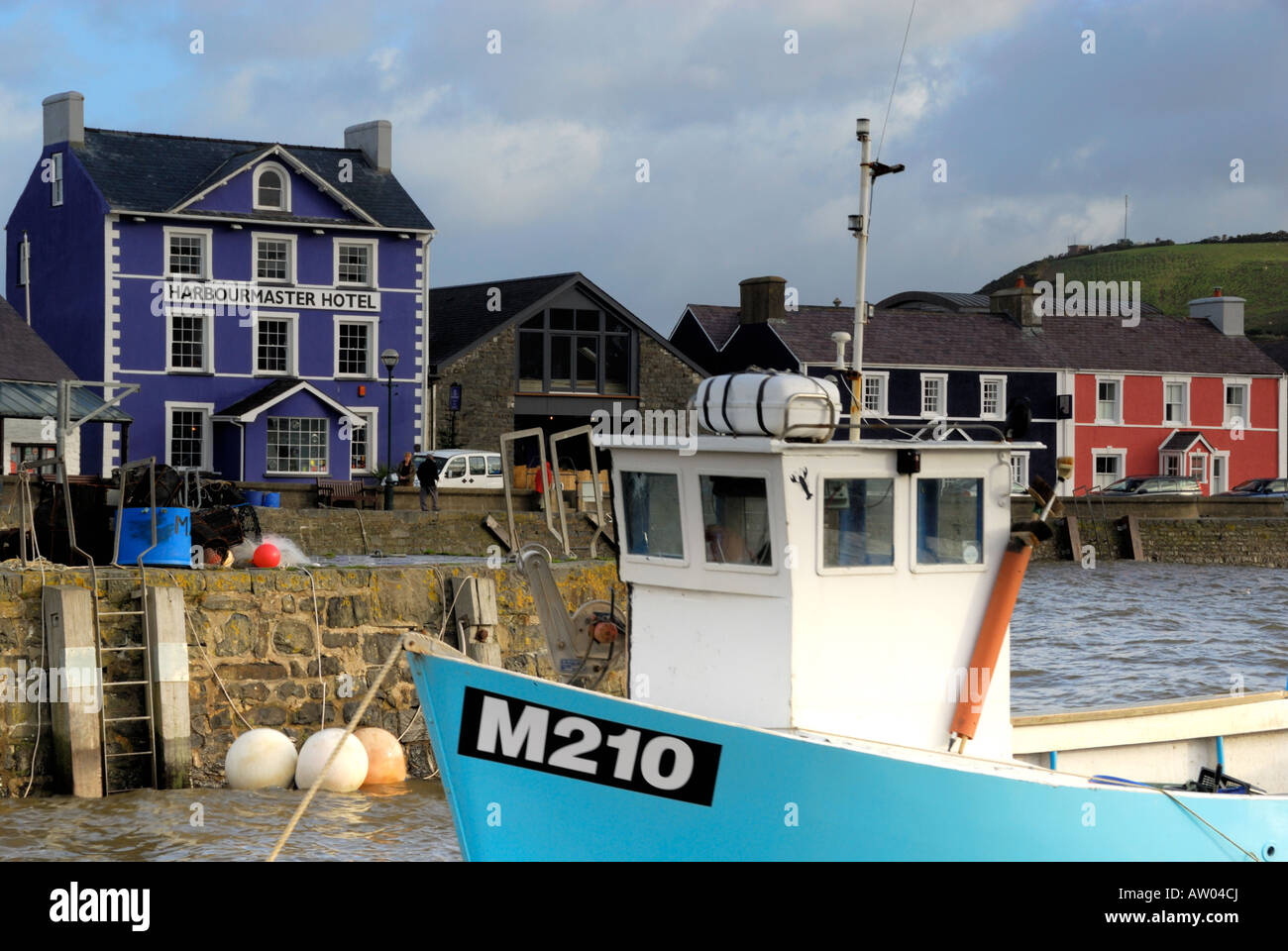 Aberaeron Harbour, Wales, with fishing boat in foreground - Stock Image