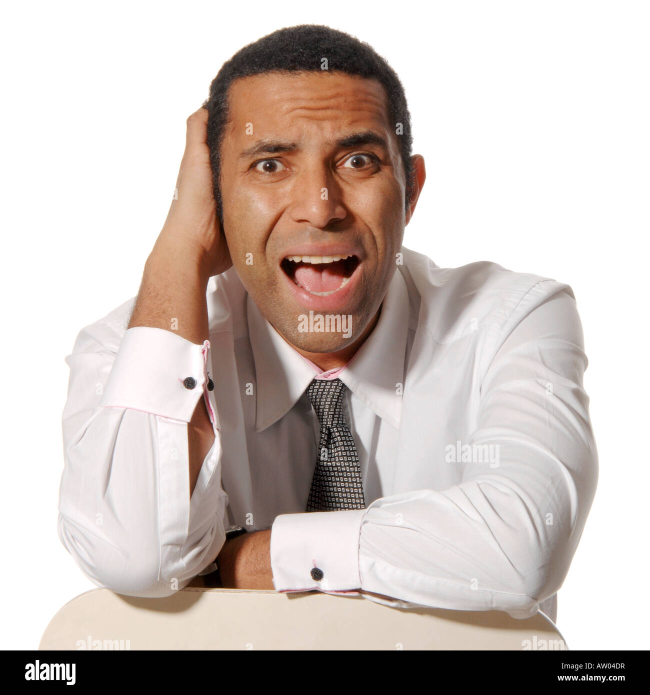 Worried and surprised businessman - Stock Image