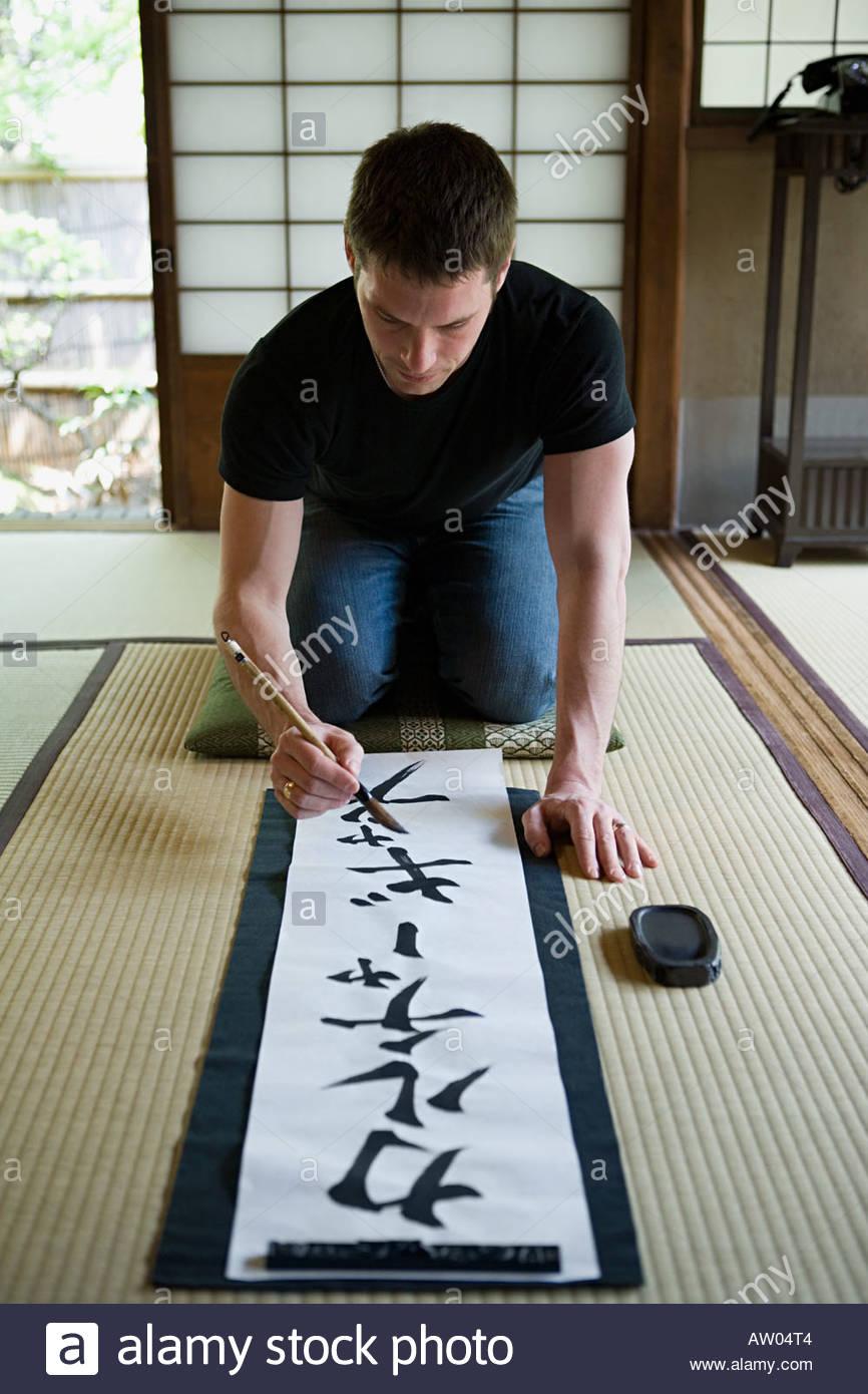Man writing japanese script - Stock Image