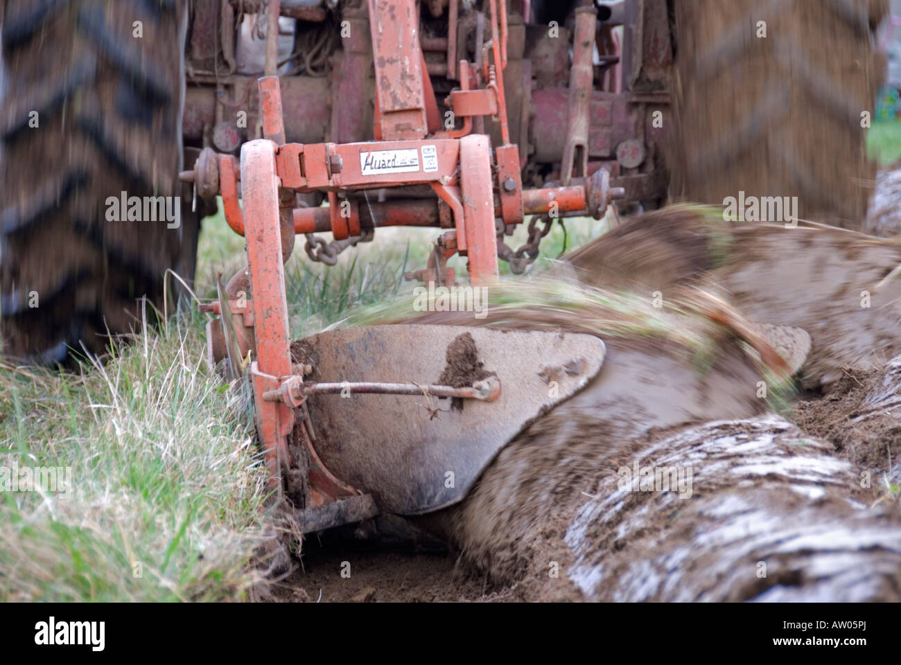 Stock photo of a plough turning the earth The picture was taken in France - Stock Image