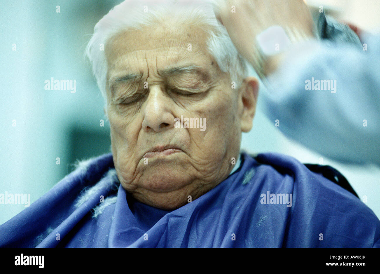 Elderly Man having a Haircut - Stock Image