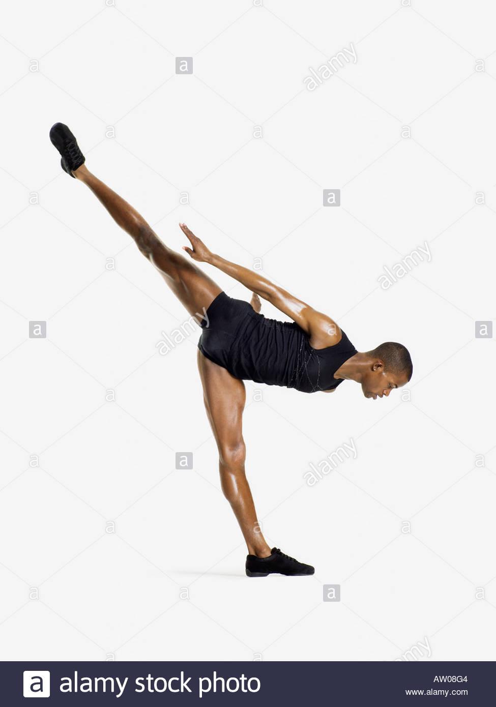 Male dancer on one leg - Stock Image