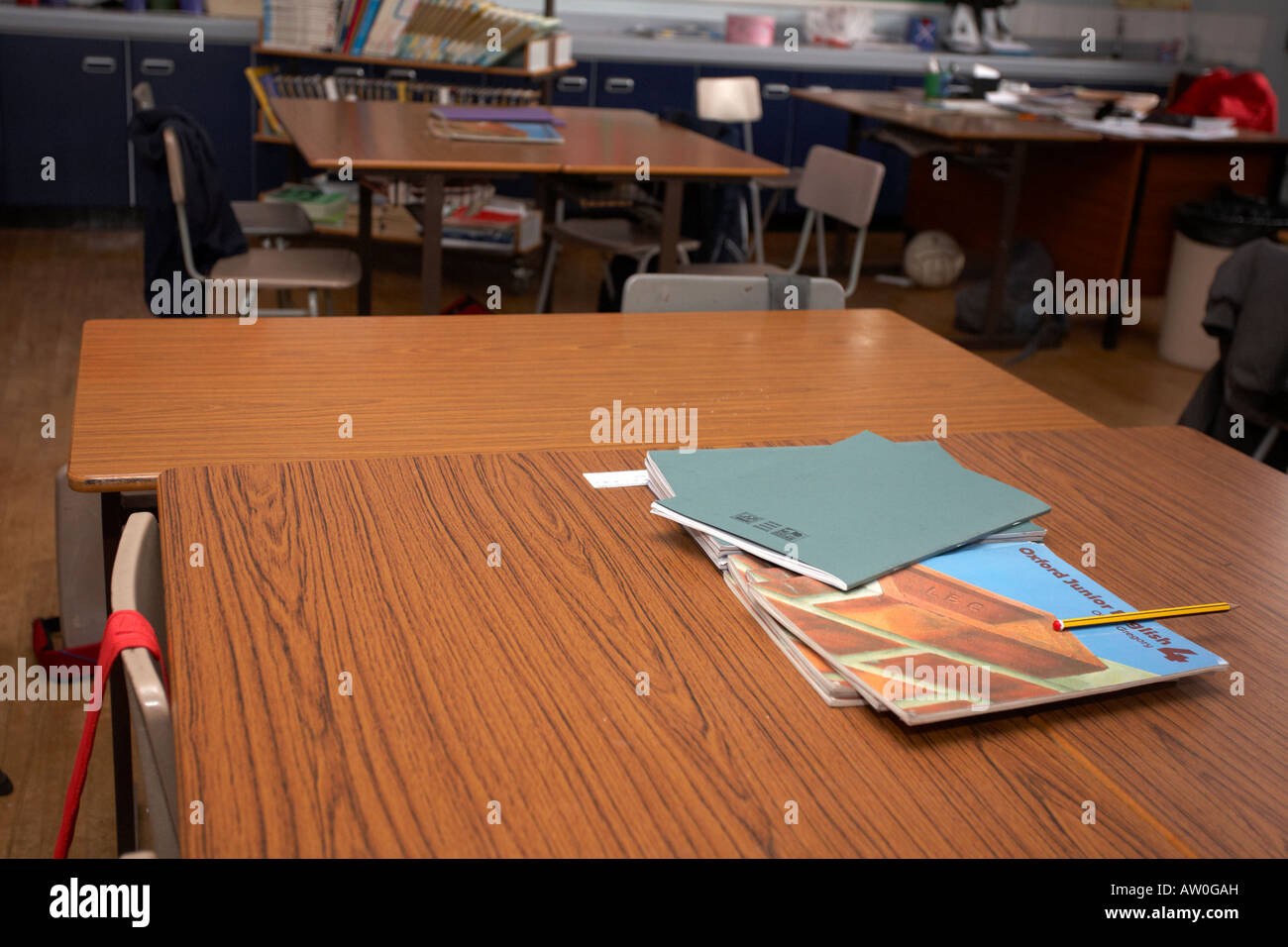 schoolbooks and english textbooks sitting on tables in an