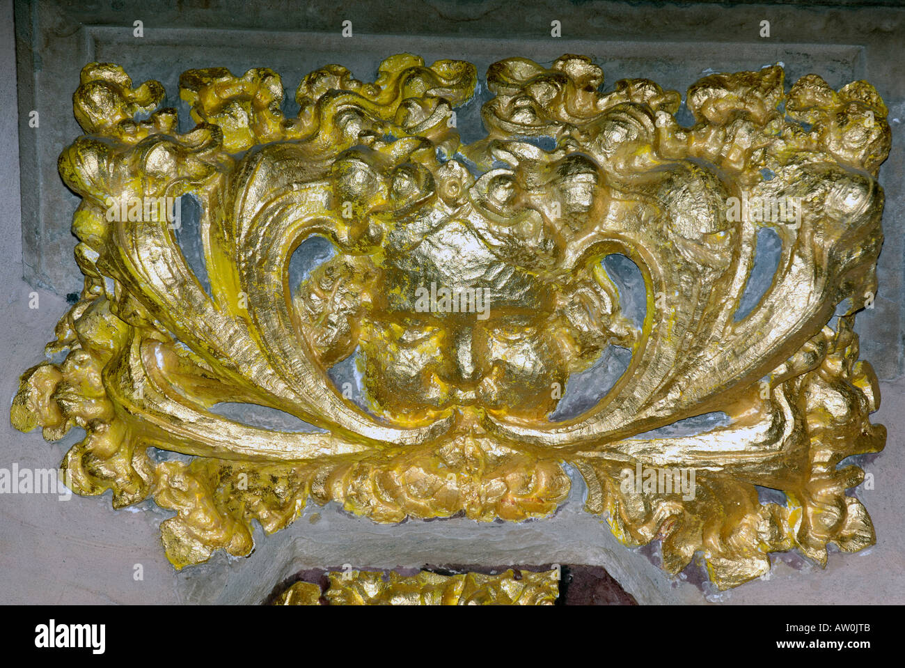 bright shiny gilded green man  roof boss st giles cathedral edinburgh scotland - Stock Image