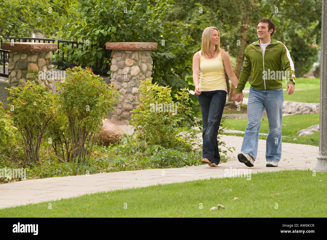 Young couple enjoying a walk in the park Stock Photo