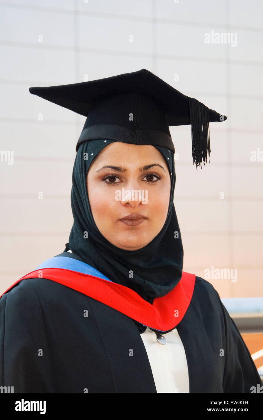 Portrait of Muslim woman graduate in cap and gown Stock Photo ...