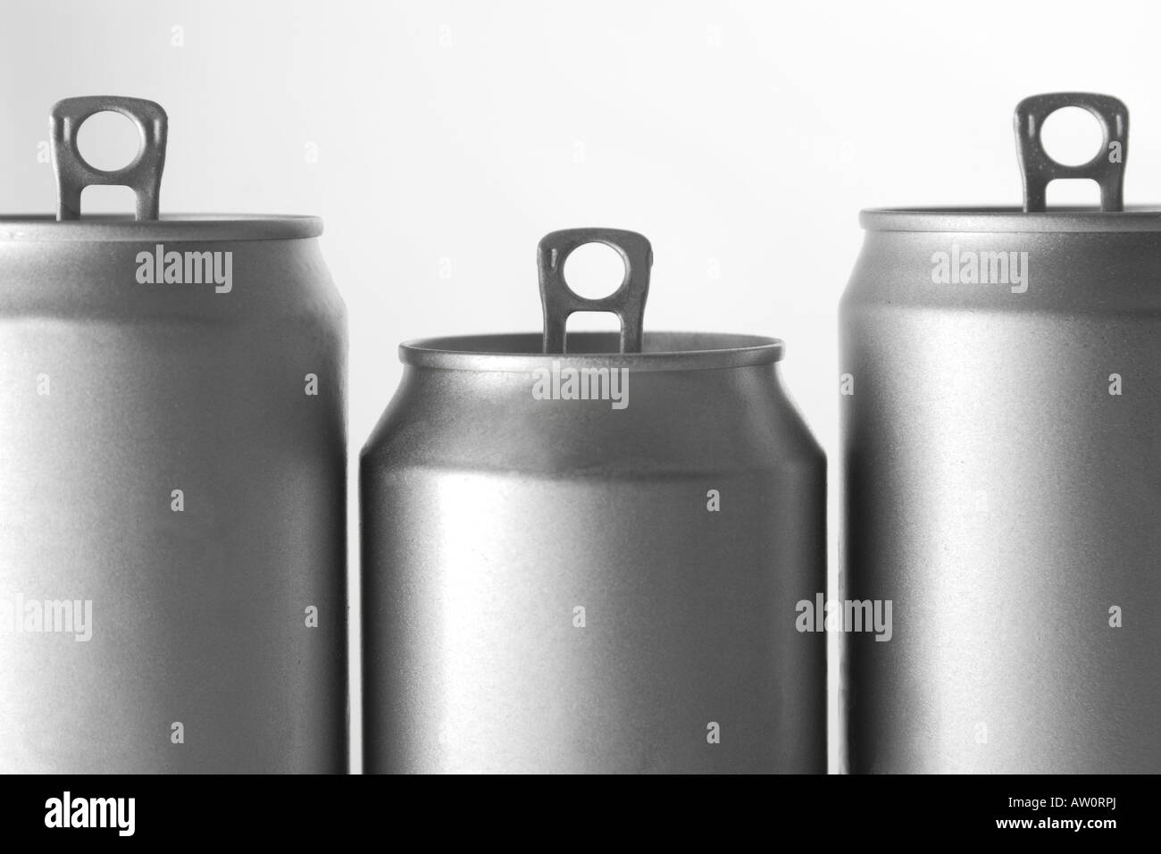 a row of soft drinks cans - Stock Image