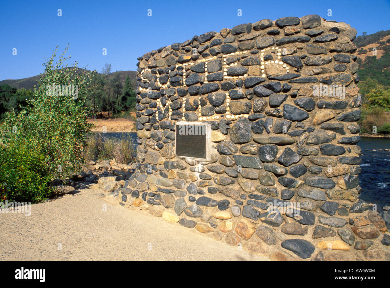 Plaque at the site of Sutters Mill Marshall Gold Discovery State Historic Park Coloma California - Stock Image