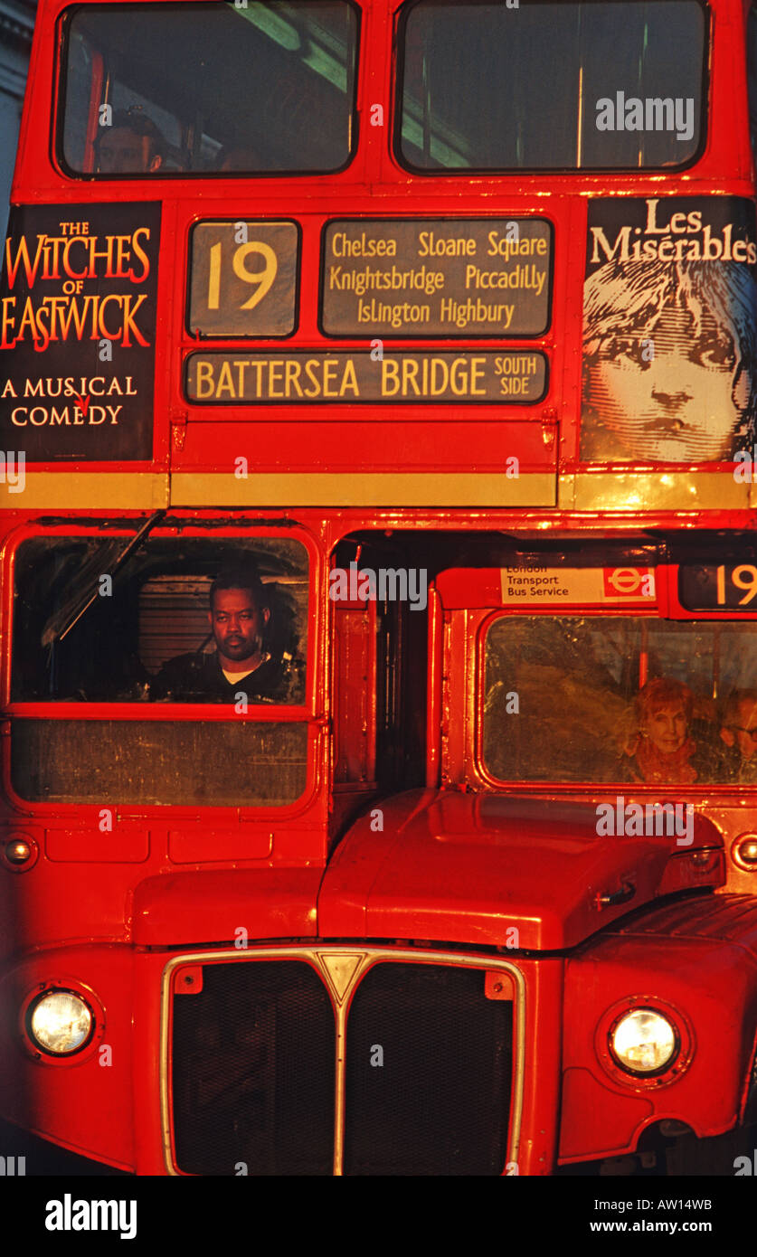 Routemaster double decker bus A few old style red buses still ply the streets of the capital London England - Stock Image