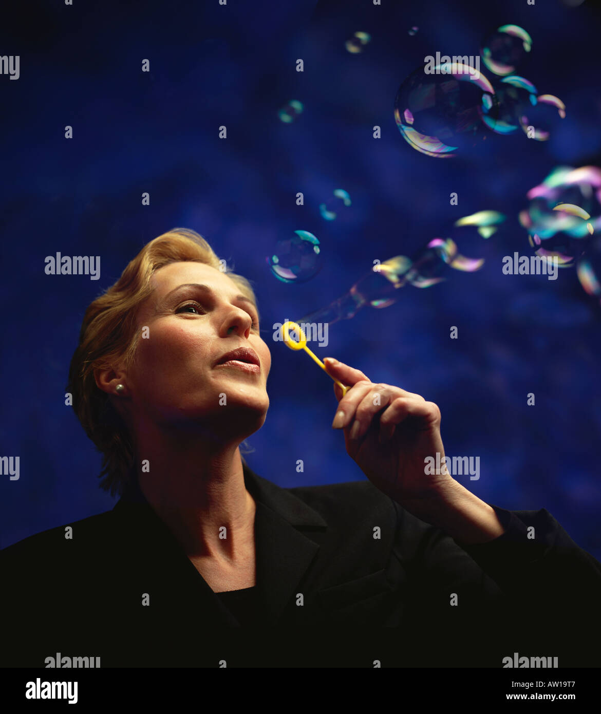 Business Woman Blowing Bubbles Stock Photo