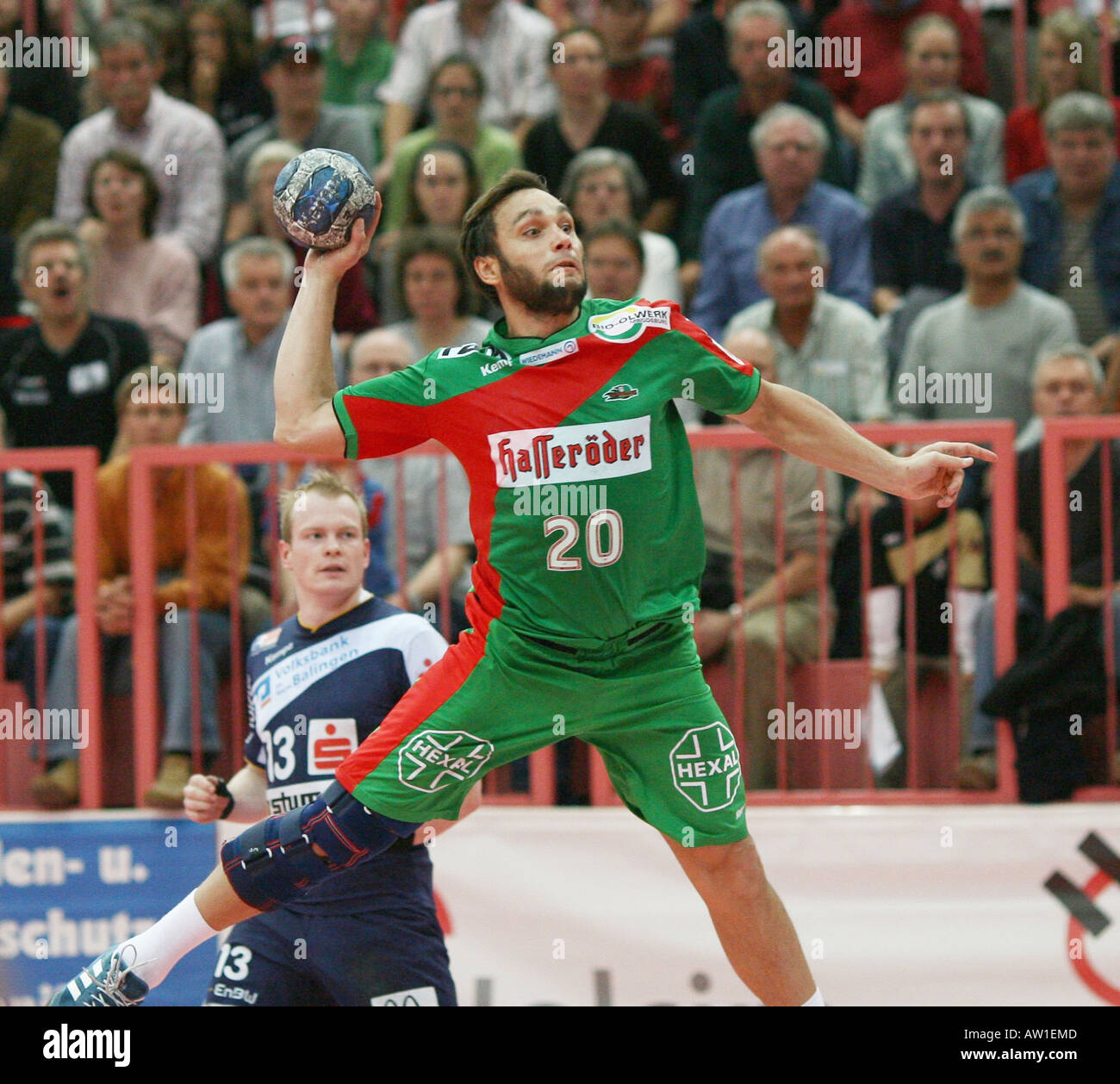 Oleg Kulechow (Magdeburg) throwing a goal - Stock Image