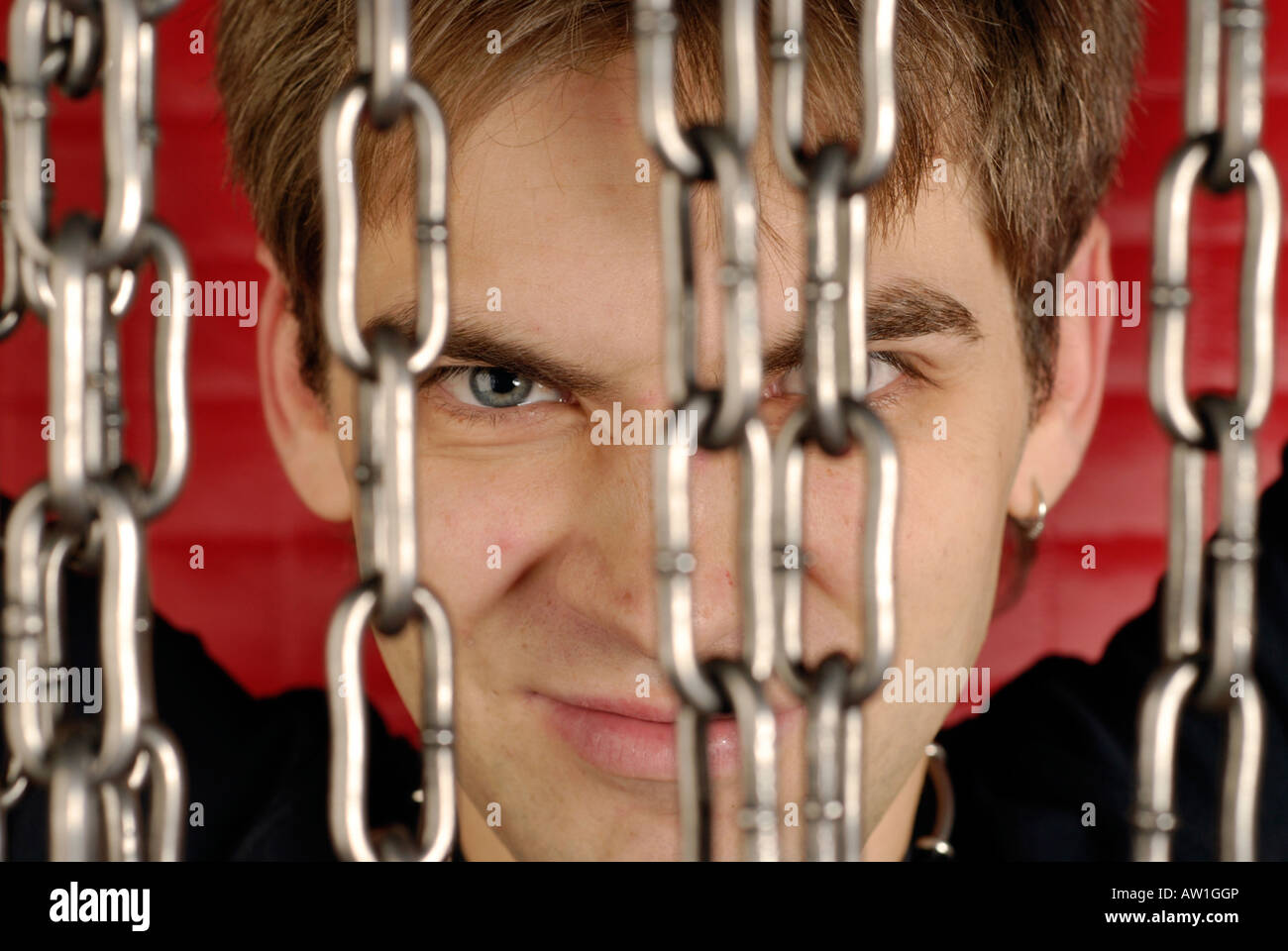 Young guy with chains. Stock Photo