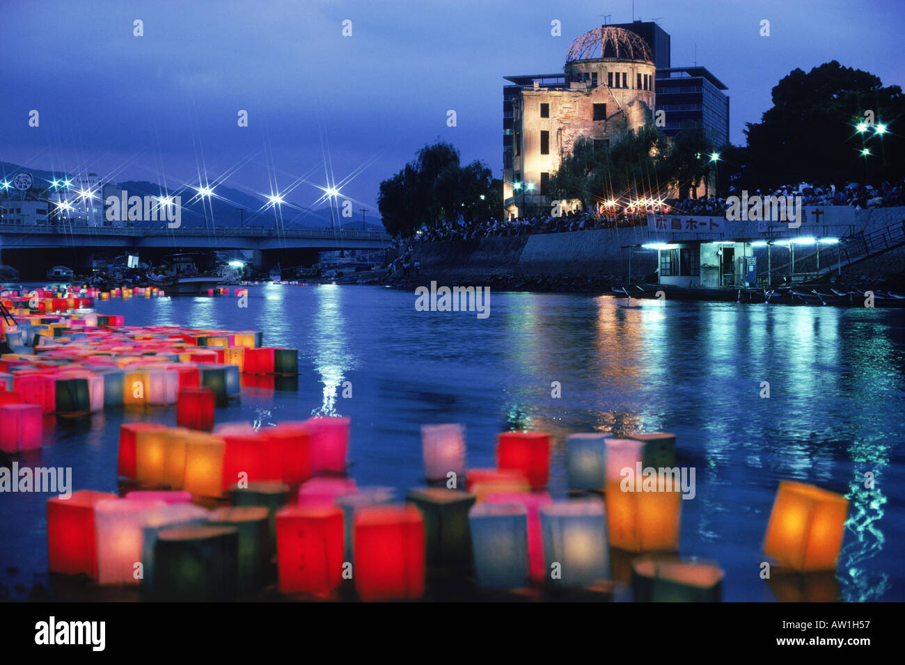 Atomic Bomb Dome with floating lamps on Motoyasu-gawa River during Peace Memorial Ceremony every August 6 in Hiroshima, Japan - Stock Image