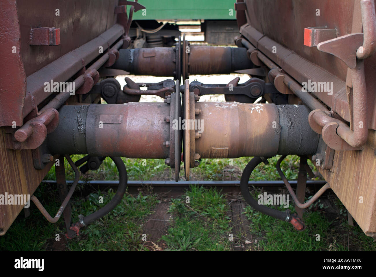 Buffers of Two Connected Railway Freight Waggons - Stock Image