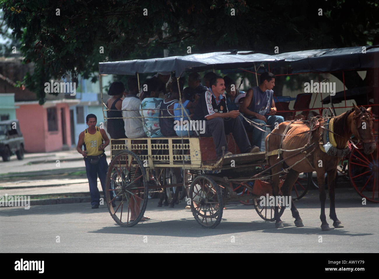 A horse and cart carrying passengers on the outskirts of Santiago A common form of intermediate transport in Cuba - Stock Image