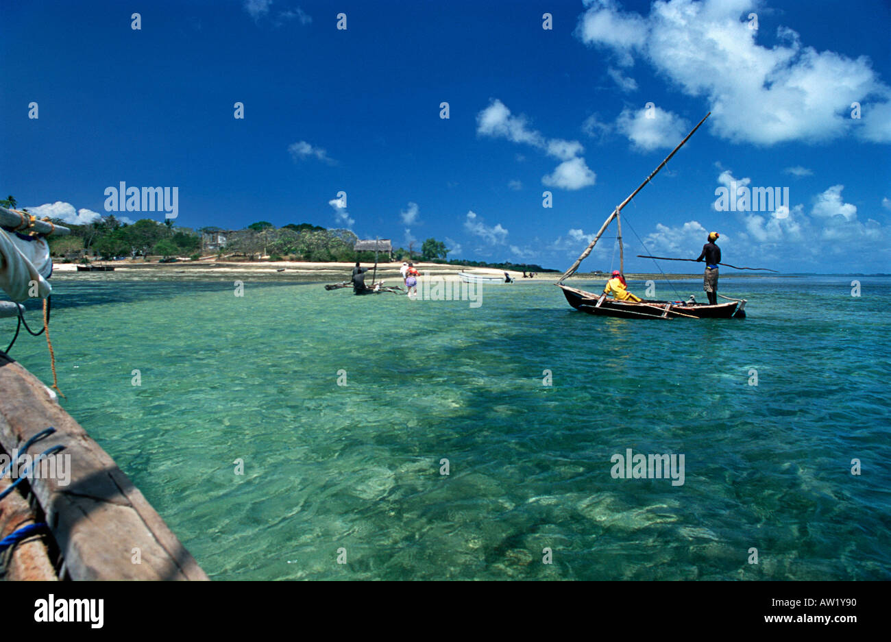 Disembarking from a dhow at low tide onto the small island of Chole beside Mafia island Tanzania - Stock Image