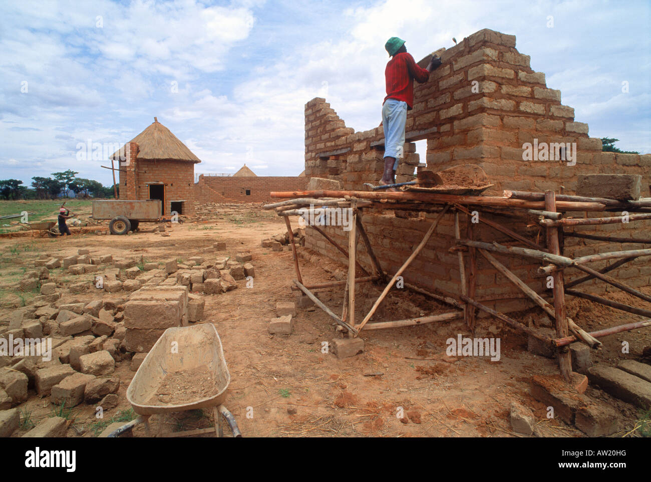 African Man Building Small Scale Brick House On Tobacco
