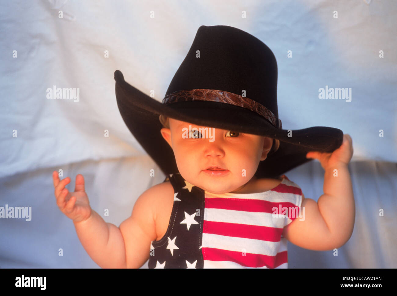 Baby 7-12 month with big cowboy hat and USA costume Stock Photo ... 6d7e9e0b3f8
