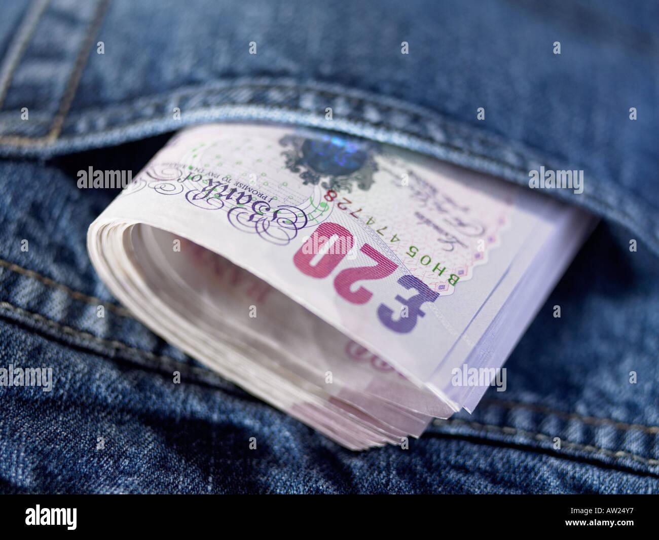 Twenty pound notes in a pocket Stock Photo